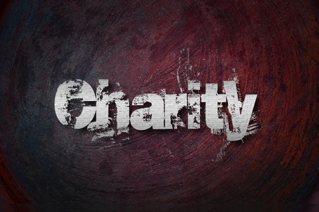 Charity Concept text on background photo