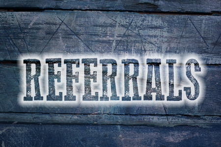 Referrals Concept text on background photo