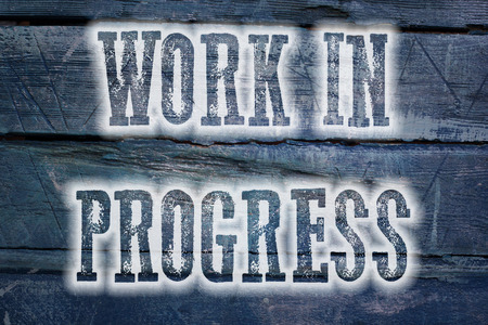 Work In Progress Concept text on background photo