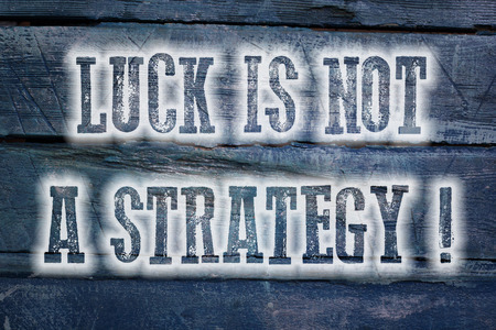 Luck Is Not A Strategy Concept text on background