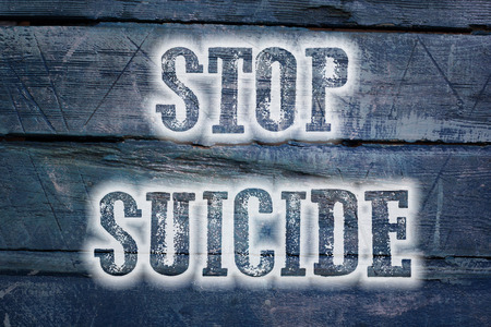 suicidal: Stop Suicide Concept text on background