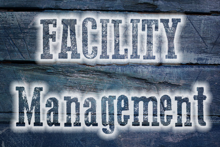 Facility Management Concept text on background photo