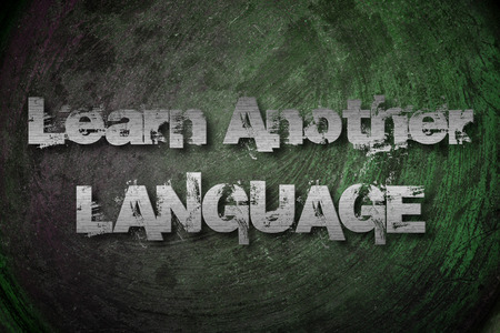 Learn Another Language Concept text on background photo