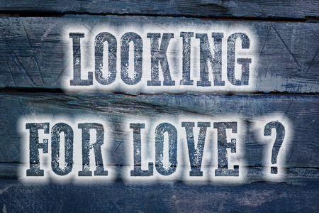 Looking For Love Concept text on background photo