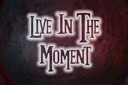 moment: Live In The Moment Concept text on background