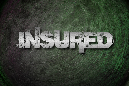 Insured Concept text on background photo