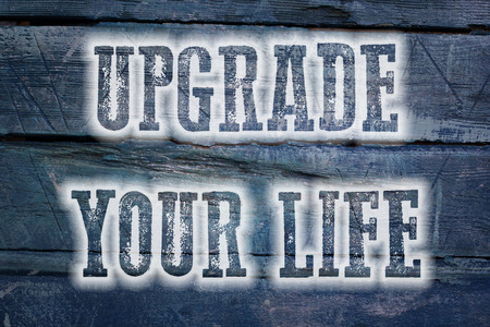 Upgrade Your Life Concept text on background photo