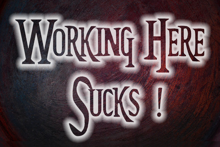 Working Here Sucks Concept text on background photo