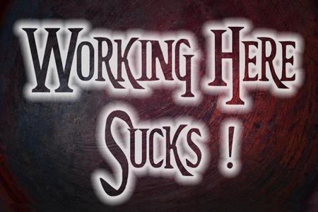low self esteem: Working Here Sucks Concept text on background Stock Photo