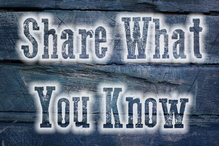 Share What You Know Concept text on background photo