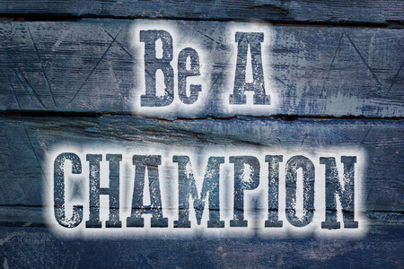 Be A Champion Concept text on background photo