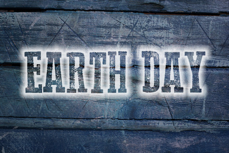 Earth Day Concept text on background photo