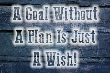 A Goal Without A Plan Is Just A Wish Concept text on background photo