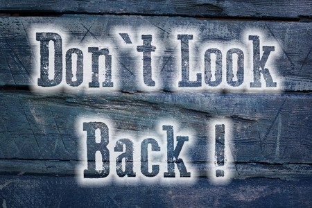 Do not look back concept text on background photo