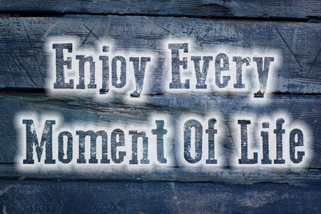 happyness: Enjoy Every Moment Of Life Concept text on background Stock Photo