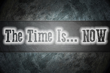 The Time Is Now Concept text on background photo