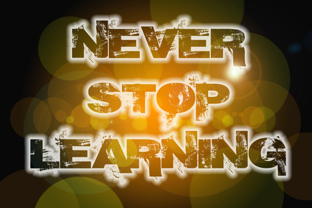 Never Stop Learning Concept text on background photo