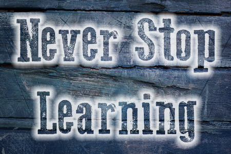 home schooling: Never Stop Learning Concept text on background