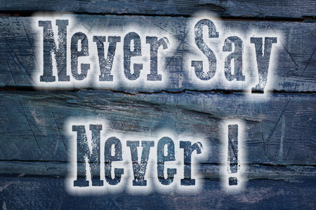 Never Say Never Concept text on background photo