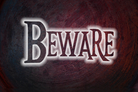 Beware Concept text on background photo