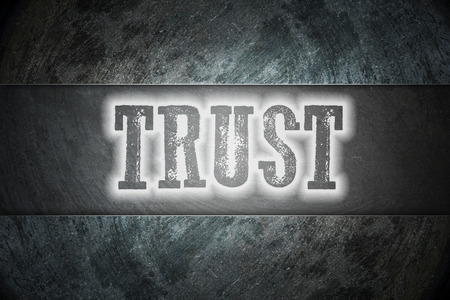 Trust Concept text on background photo