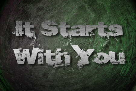 It Starts With You Concept text on background photo