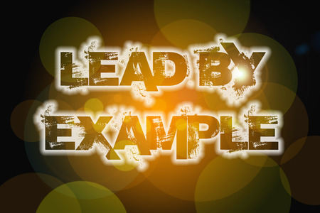 Lead by example Concept text on background photo