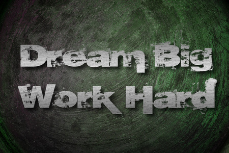 Dream Big Work Hard Concept text on background photo