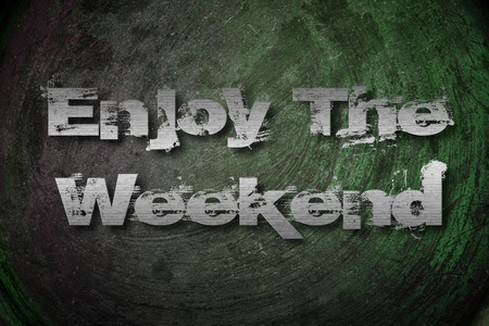 Enjoy The Weekend Concept text on background photo