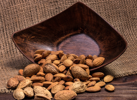 almond nuts scattered on sacking