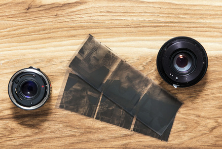 Old camera lenses and negative film photo