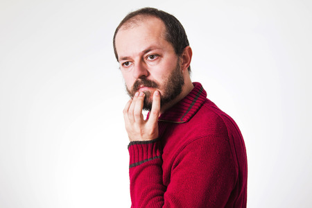 skeptic: Man in red sweater, with beard and mustaches in skeptic pose Stock Photo