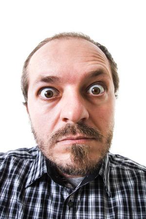 chemise carreaux: Surpris l'homme en chemise � carreaux, les yeux grands ouverts Banque d'images