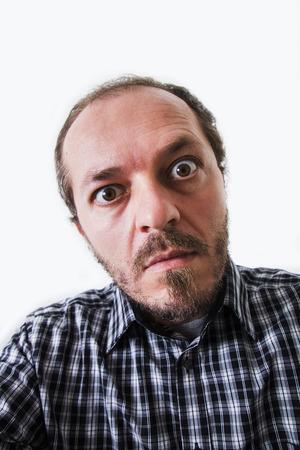 eyes wide: Surprised man in plaid shirt, eyes wide open