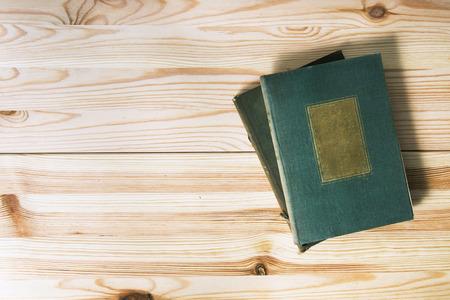 old desk: Old books on natural wooden desk