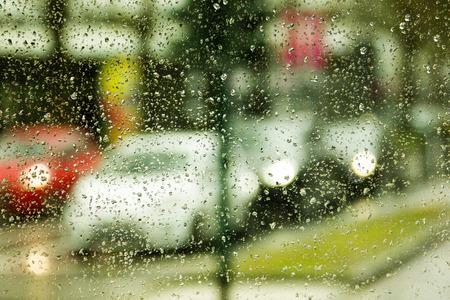 Rainy day on the street, view through the car window Stock Photo