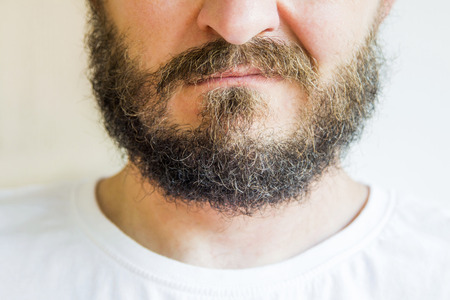 skeptic: Close up of long beard and mustache man, skeptic expression