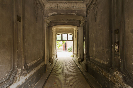 decayed: Decayed corridor in an abandoned residential building Stock Photo