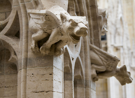 heads old building facade: Gargoyle, detail on the facade of the cathedral in Zagreb Croatia
