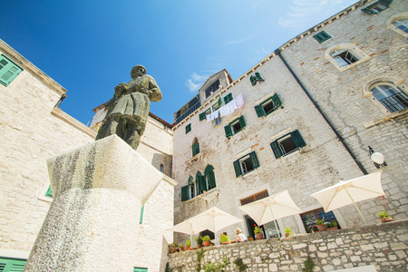 public houses: Statue and old traditional houses on public square in Sibenik, Croatia Editorial