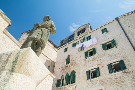 public houses: Statue and old traditional houses on public square in Sibenik, Croatia Stock Photo