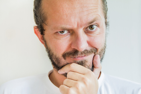 skeptic: Man with beard and mustaches, skeptic and mean expression Stock Photo