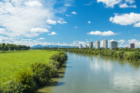 embankment: River Sava and Zagreb modern skyline, summer midday