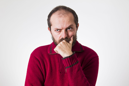 skeptic: Man in red sweater, with beard and mustaches, confused and skeptic