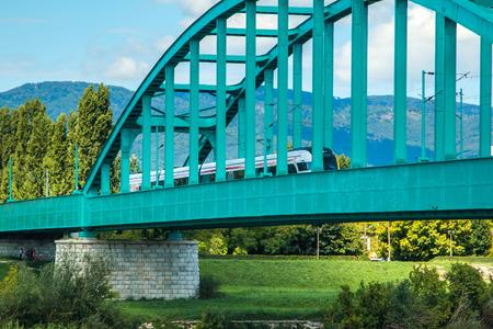 zagreb: New modern fast train crossing green Railway bridge over Sava river in Zagreb, Croatia Stock Photo