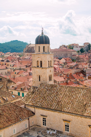 view of an atrium in a building: Church tower and red roofs in old town Dubrovnik, Croatia, UNESCO site, panoramic view