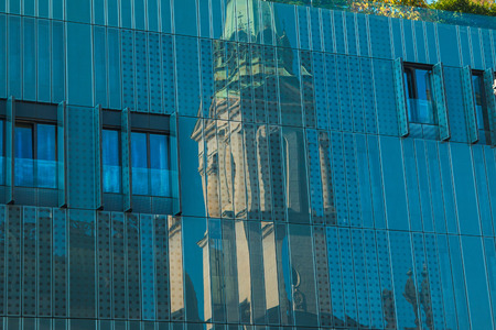church flower: Reflection of orthodox church in facade of modern business building on Preradovic square Flower square