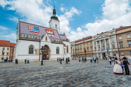 Zagreb, Croatia, May 31th 2015: St Marks Square in Zagreb, Croatia, surrounded by tourists. St Marks square is political center of Croatia and popular tourist location. Sajtókép