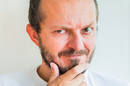 skeptic: Man with beard and mustaches, skeptic expression Stock Photo