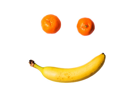 mandarina: Smiling fruits banana and tangerine isolated on a white background